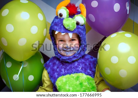Happy birthday funny  face of a boy dirty with cake cream - stock photo