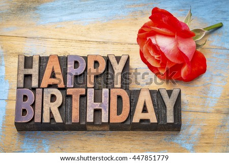 Happy Birthday greeting card - text in vintage letterpress wood type stained by color inks with a red rose - stock photo
