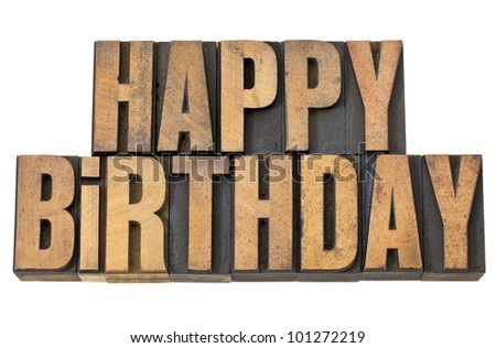 happy birthday greetings - isolated words in vintage letterpress wood type - stock photo