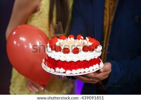 Happy birthday! Group people holding cake. - stock photo