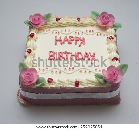 Happy birthday is written in square cake - stock photo