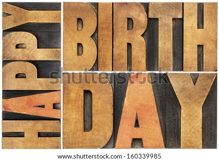 happy birthday - isolated text abstract - letterpress wood type printing blocks scaled to a rectangle - stock photo