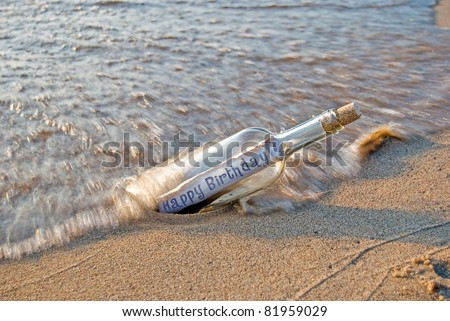 happy birthday message in a bottle - stock photo