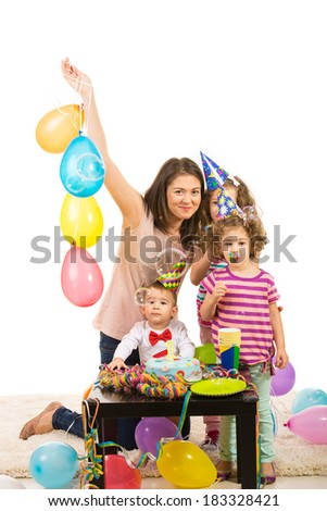 Happy birthday of toddler boy with cake,balloons and soap bubbles - stock photo