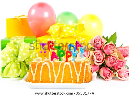 happy birthday! party decoration with roses flowers, cake, balloons, gifts and candles