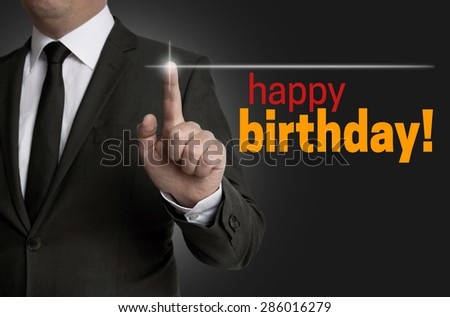 Happy Birthday touchscreen is operated by businessman. - stock photo