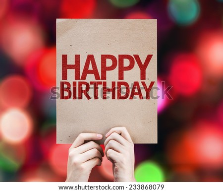 Happy Birthday written on colorful background with defocused lights - stock photo