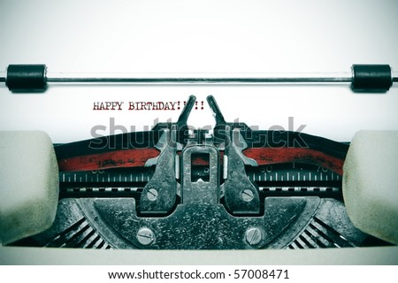 happy birthday written with an old typewriter - stock photo