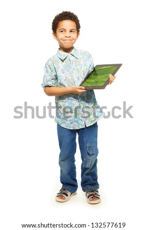 Happy black boy with tablet computer and happy smile as he shows images on the screen (image from photographers portfolio) - stock photo