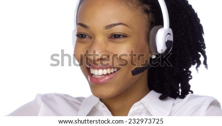 Happy black businesswoman talking with headset - stock photo
