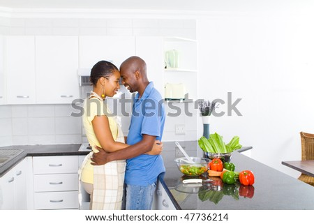 happy black couple in modern kitchen