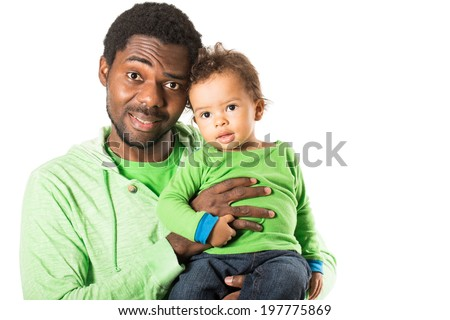 Happy black father and child boy cuddling on isolated white background. Use it for baby, parenting or love concept - stock photo