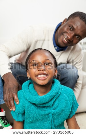 Happy black girl in christmas with her dad - stock photo