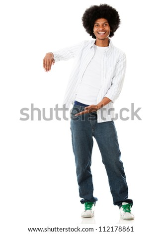 Happy black man displaying something with his hands - isolated over white