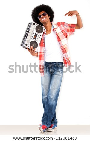 Happy black man with a radio enjoying the music