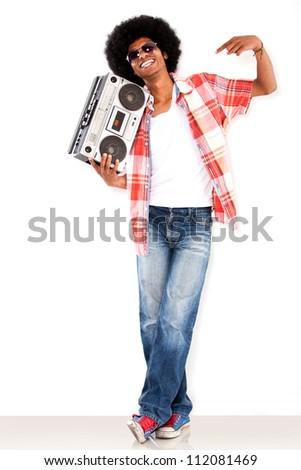 Happy black man with a radio enjoying the music - stock photo