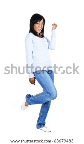 Happy black woman celebrating isolated on white background