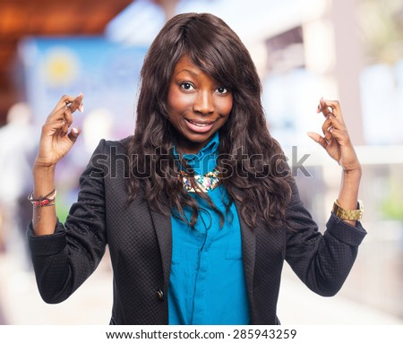 happy black-woman crossing fingers - stock photo