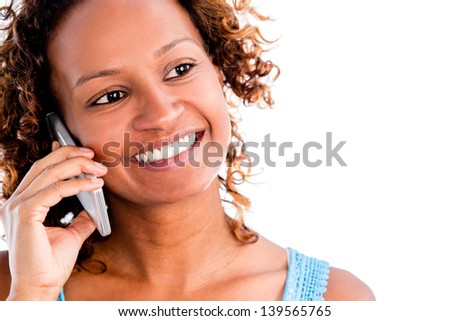 Happy black woman talking on the phone - isolated over a white background