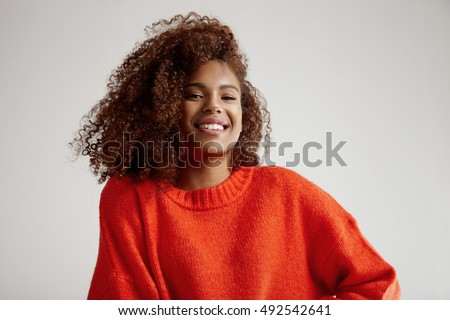 happy black woman with big curly afro hair
