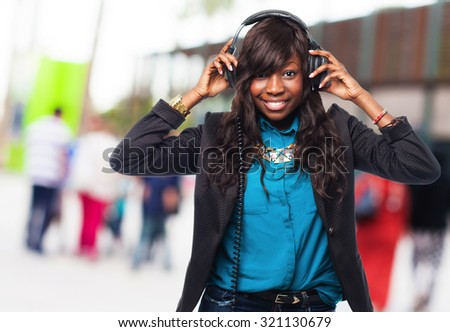 happy black woman with headphones
