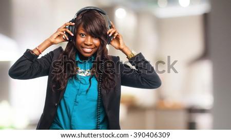happy black woman with headphones - stock photo