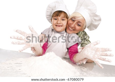 Happy, blond caucasian mother and daughter preparing dough and having fun