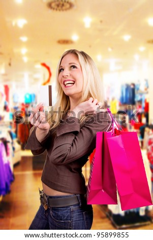 Happy blond woman with shopping bags - stock photo