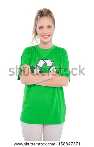 Happy blonde activist wearing recycling tshirt posing on white background - stock photo