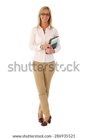 Happy blonde businesswoman holding folders, smiling, looking at camera. Full size. - stock photo