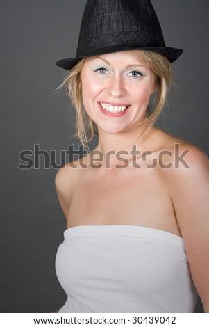 Happy Blonde Girl in Black Hat - stock photo