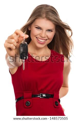 Happy blonde holding car key, isolated on white background. Beautiful young joyful female new car owner.    - stock photo