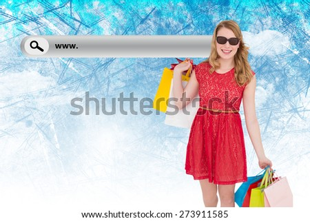 Happy blonde holding shopping bags against painted sky - stock photo