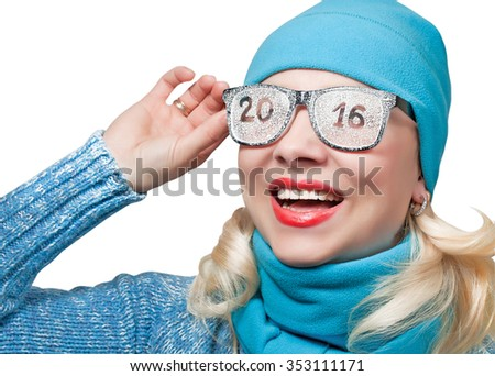 Happy blonde looking off in the sports cap with the inscription on the glasses 2016 - stock photo