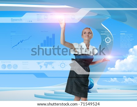 Happy blonde using technologies of the future - stock photo