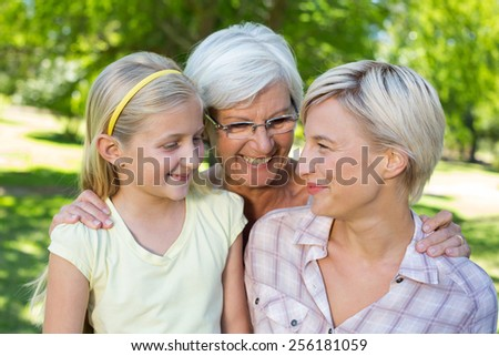Happy blonde with her daughter and grandmother on a sunny day - stock photo