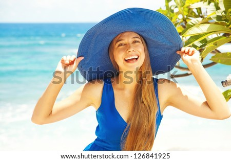 Happy blonde woman against sea water - stock photo