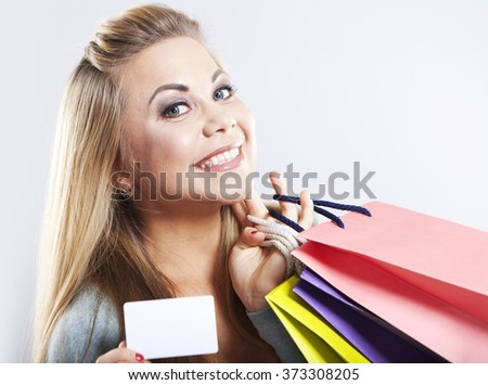 Happy blonde woman hold shopping bag. Shopping with credit card. Smiling girl - stock photo