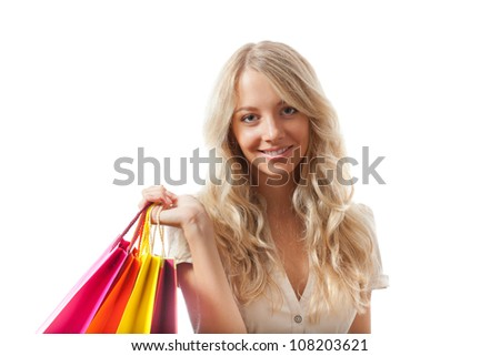 happy blonde woman holding shopping bags over white looking at camera