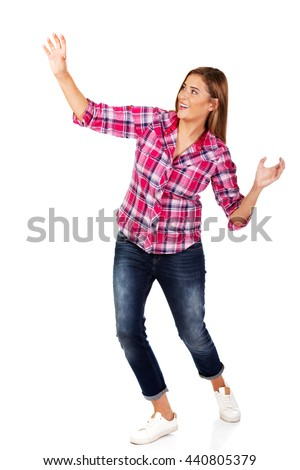 Happy blonde woman standing with hands up  - stock photo
