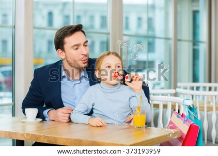 Happy blowing bubbles family. - stock photo