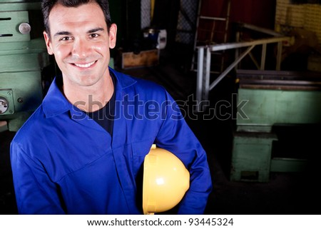 happy blue collar worker portrait in factory - stock photo