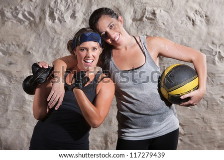 Happy boot camp training partners with weight and medicine ball - stock photo