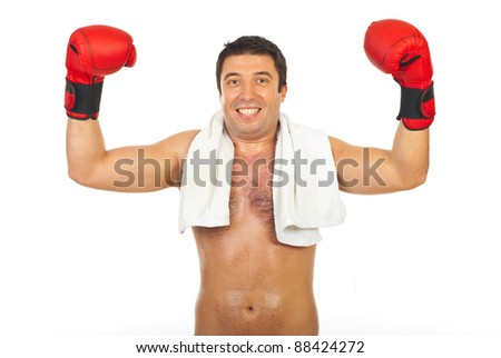 Happy boxer man winner raising arms isolated on white background - stock photo