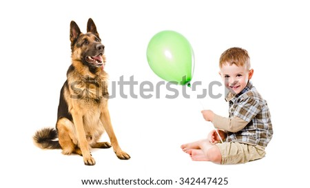 Happy boy and German Shepherd playing a balloon, isolated on white background