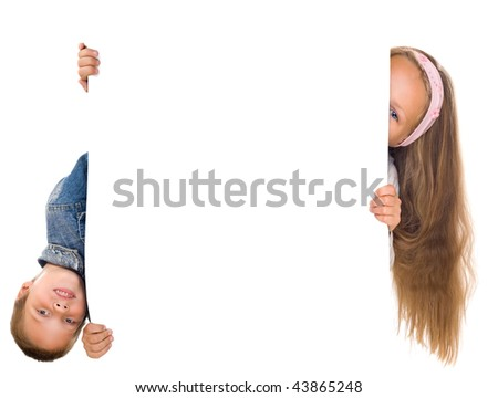 happy boy and girl hold together large white blank isolated on white - stock photo
