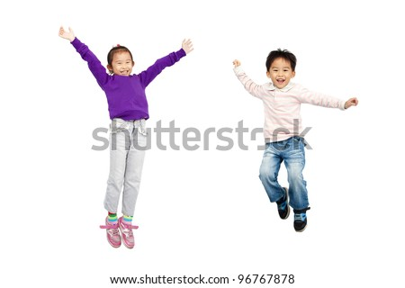 happy boy and girl jumping together - stock photo