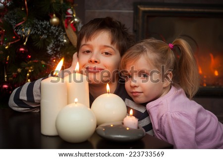 happy boy and girl with candles  - stock photo