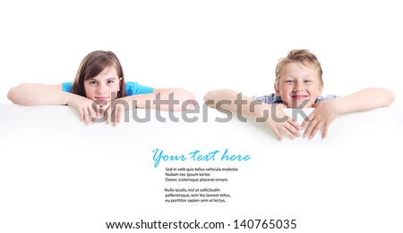 Happy boy and girl with place for your text. - stock photo