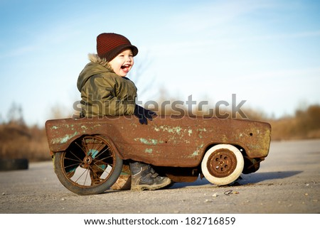 Happy boy and his toy car - stock photo